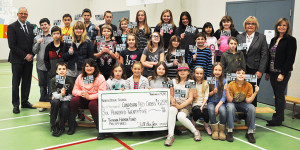 """With the theme of """"Fill the Jar"""" students at North Otter Elementary School raised $625 for the Canadian Red Cross Typhoon Haiyan Fund for relief to the Philippines. Photo Credit: Harry Hunt"""
